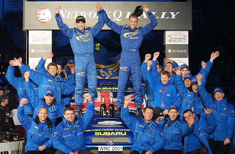 Rd.1VVV-4GB_R.Burns podium 01 Driver_Champion_WRC2001_098a