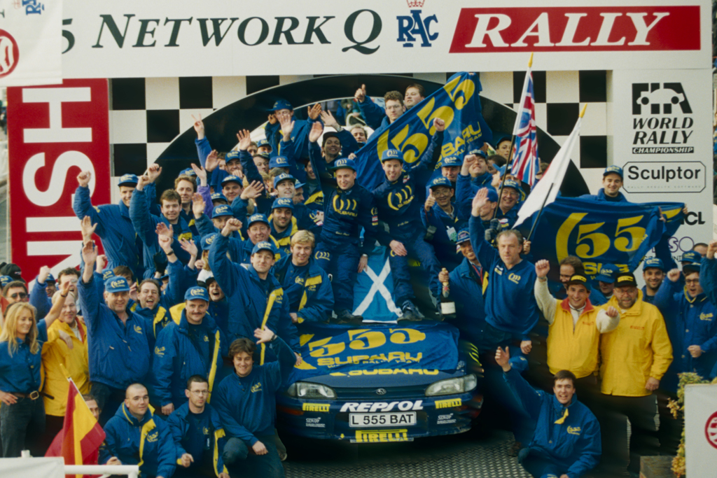 VRd.8RAC_C.McRae podium 9th victory_093a